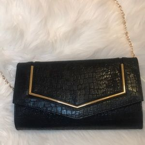Gianni Bini black and gold clutch
